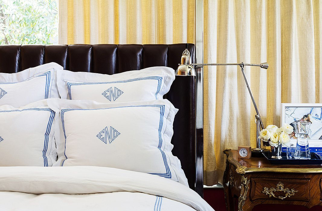 "Classic details found in the master bedroom include the reupholstered Ralph Lauren Home headboard and David's Louis XV desk (""It came from my parents' apartment in New York; I grew up with that""), where he's been working on a book about the French decorator François Catroux."