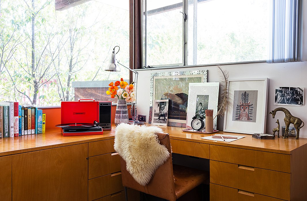 True to David's nothing-is-sacred decorating mantra, his daughter's bedroom work space is anything but juvenile. Black-and-white photography is paired with brass animal figures and an old record player for a whimsical note.