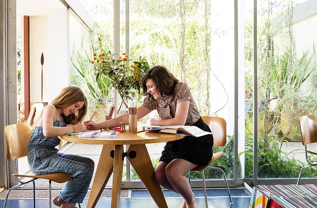 The Prouvé-style dining table doubles as a work space for daughters Madelyn and Kate, who lay out their homework, as well as David for when he's going over furniture plans after everyone else has gone to bed.