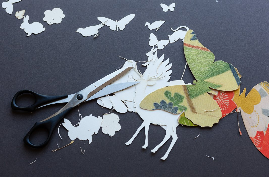 "Wolfe draws her forest creatures freehand before having them die-cut. To play up the details, she finishes the job by hand. The tedious work is a ""tactile and visceral experience."""