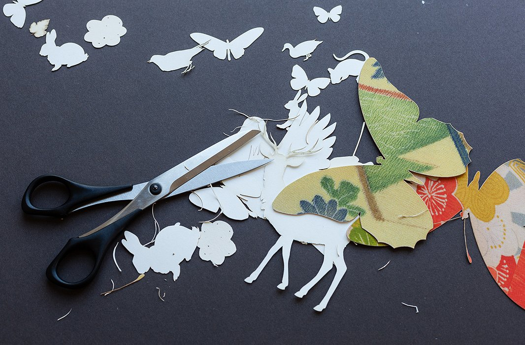 """Wolfe draws her forest creatures freehand before having them die-cut. To play up the details, she finishes the job by hand. The tedious work is a """"tactile and visceral experience."""""""