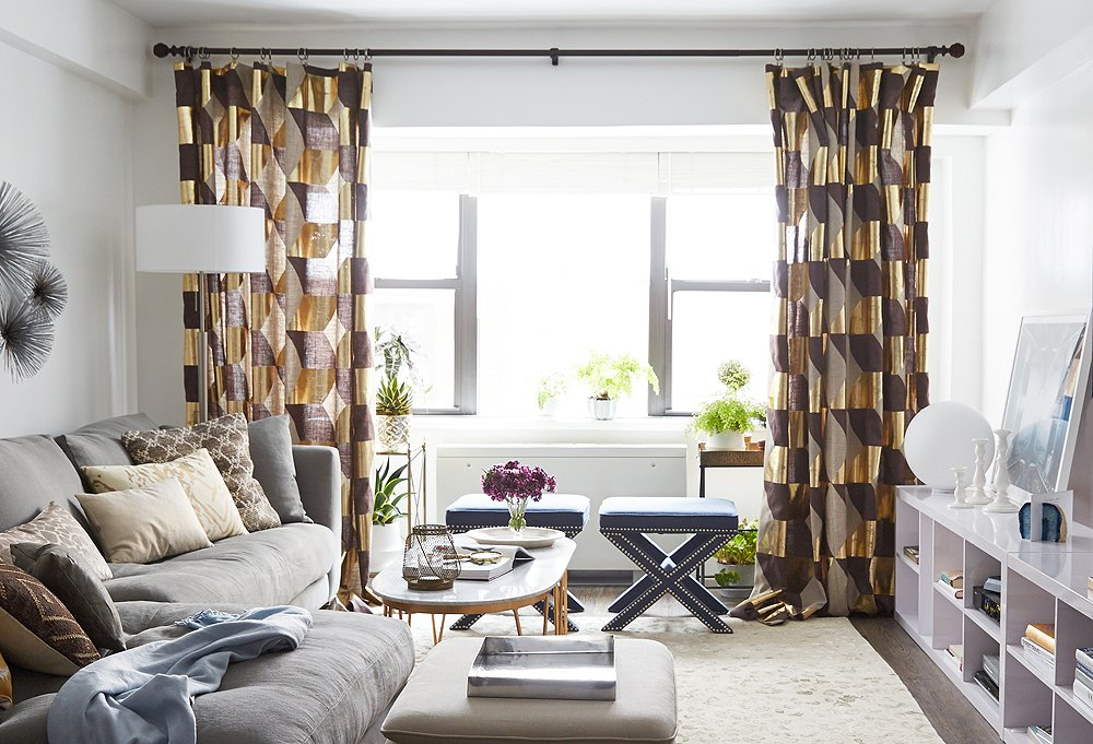 Look how tall the ceilings in this petite living room look thanks to the high-hanging curtains.
