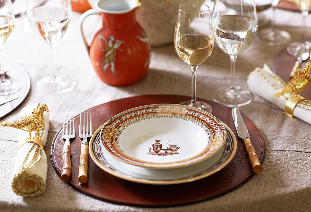 "Hits of burnt orange keep this holiday-ready tablescape cohesive. ""Color is one of the most unifying ways to pull disparate elements together,"" Dransfield says."