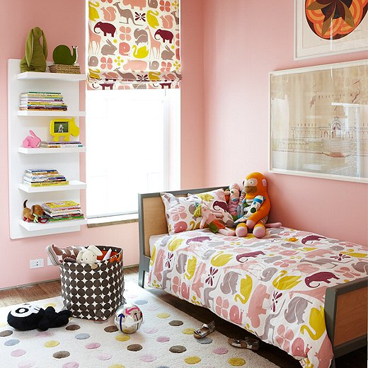 "Together, Isabelle and Lemieux chose a statement color for her bedroom, Benjamin Moore's ""Popsicle."""