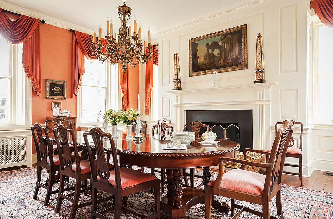 "Furnished with pieces inherited from John's grandmother's Park Avenue apartment, the dining room is ""quite formal,"" Elizabeth says."