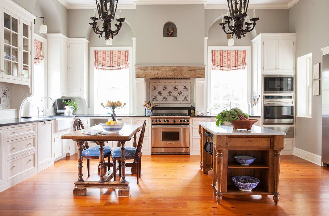 """A table in the kitchen makes an easy perch for morning list making and organizing the day. Elizabeth often has company, though—as she says, """"This is where everyone always hangs out."""""""