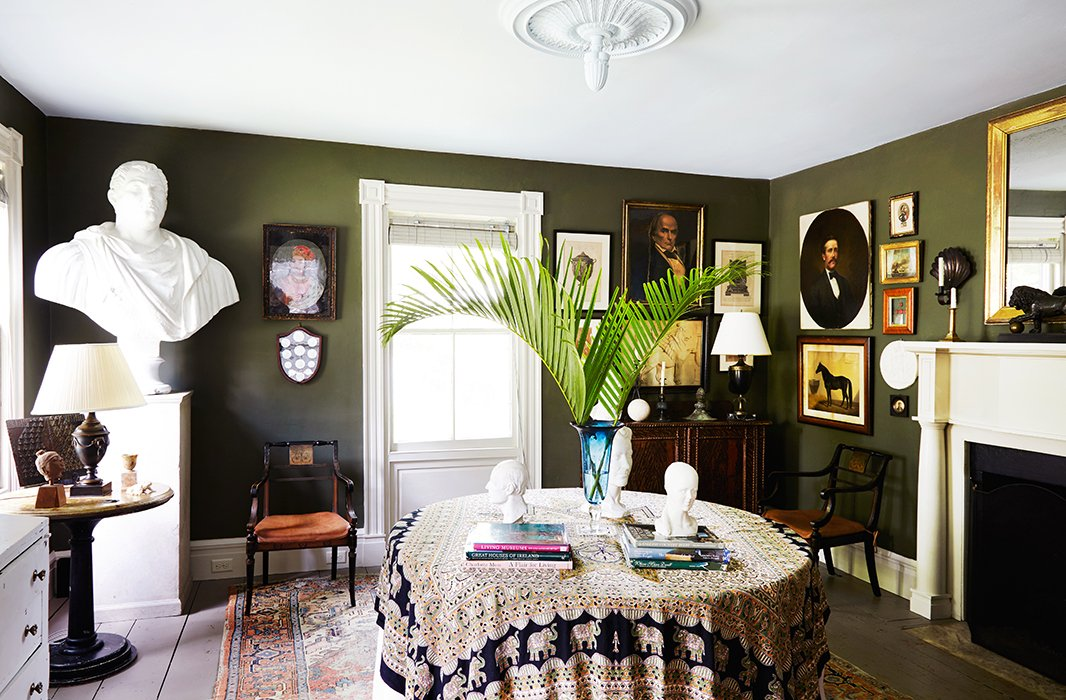 A deep green hue lends depth to a small dining room in artist Frank Faulkner's upstate New York home. Photo by Pernille Loof.
