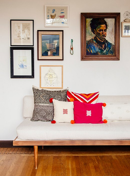 Another quiet area in Erica's home finds a gallery wall of prints and pillows in bright textiles—Erica's weakness, as she reveals in the book.