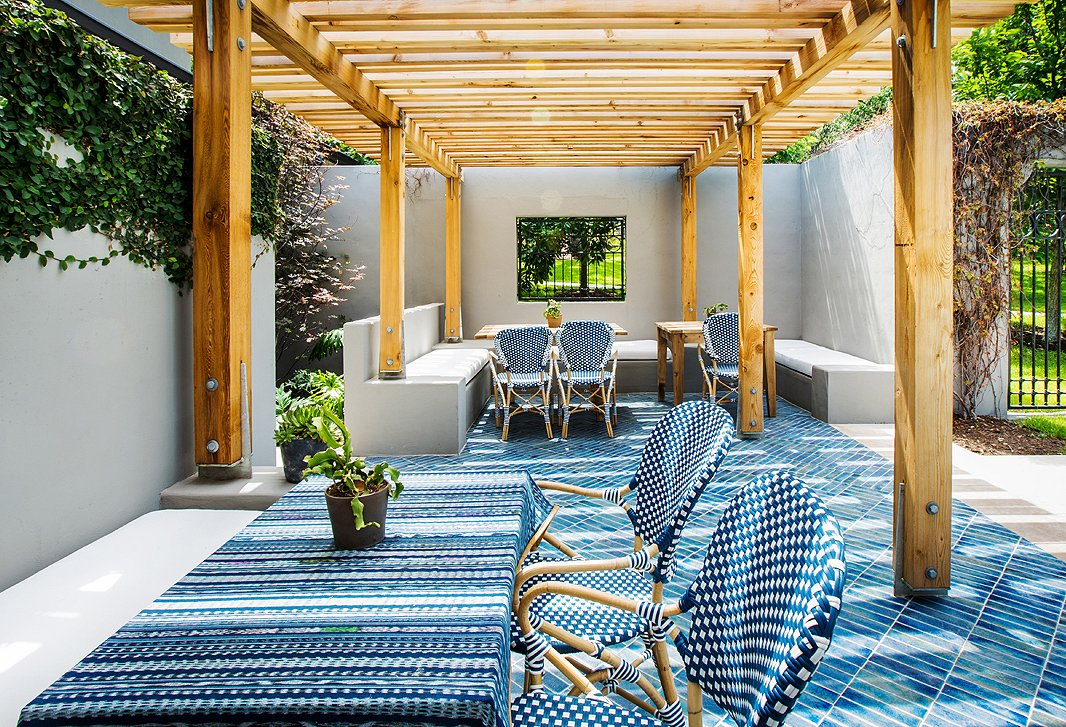 After guests expressed a desire to sip and sup alfresco, the hotel built this arbor. Tile from Ann Sacks's Design & Direct Source and bistro chairs complete the dreamy sidewalk café feel.