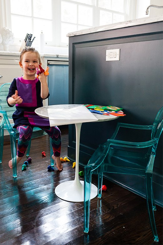 A special spot was created for the littlest members of the family, who use the space for everything from eating to coloring. The mini marble table was chosen to coordinate with the countertops.