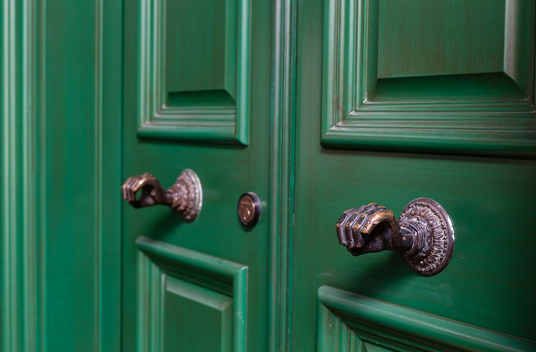 Opulence trickles down to the smallest of details in the house, such as sculptural doorknobs in the form of hands.