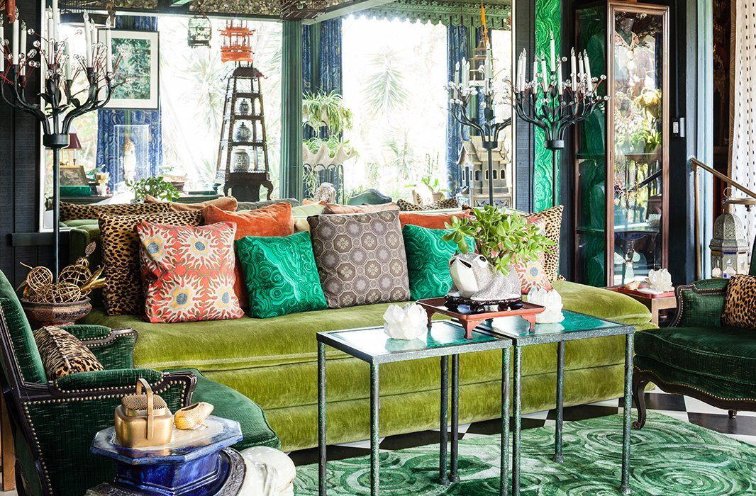 This garden room inside Dawnridge is testament to the late Duquette's legacy and fearless approach to pattern: The walls are upholstered in the decorator's malachite-print cotton fabric, which he designed for Jim Thompson, while the malachite-pattern silk rug was a design for Roubini.