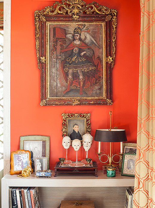 Pieces with special significance, including a small portrait of an ancestor, are showcased in a corner.
