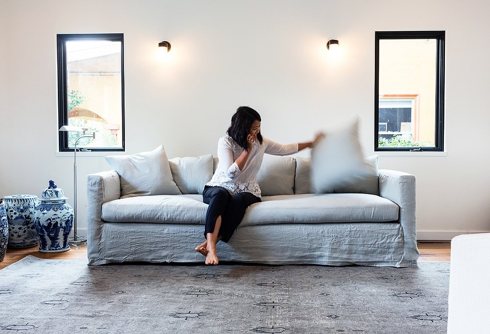 Alex chose this pale-blue linen couch for its laid-back California vibe and easy-to-clean slipcover.