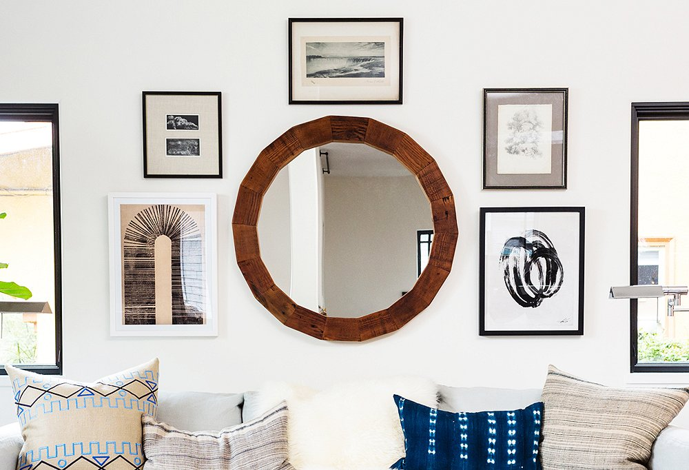 A mix of shapes—round and square—adds visual interest to this gallery wall.