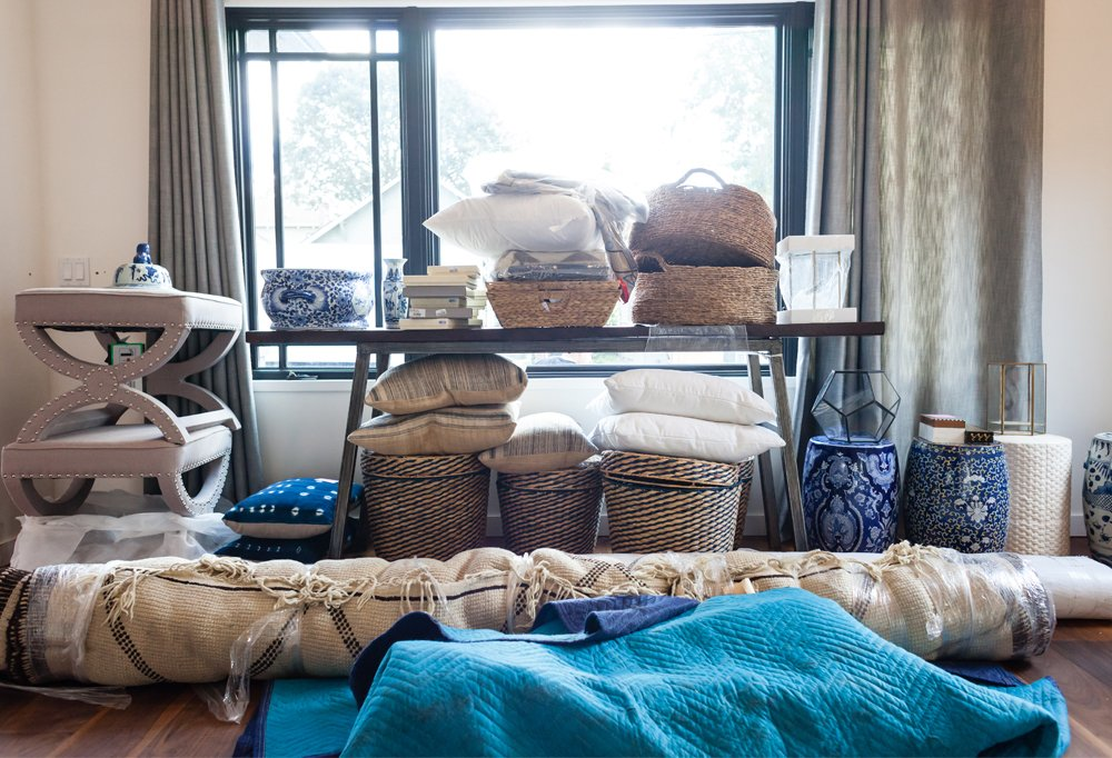 As they were unpacking, One Kings Lane's Alex and Kate grouped similar items together—pillows with pillows, art with art—so that they could easily spy the pieces they needed as soon as they needed them.