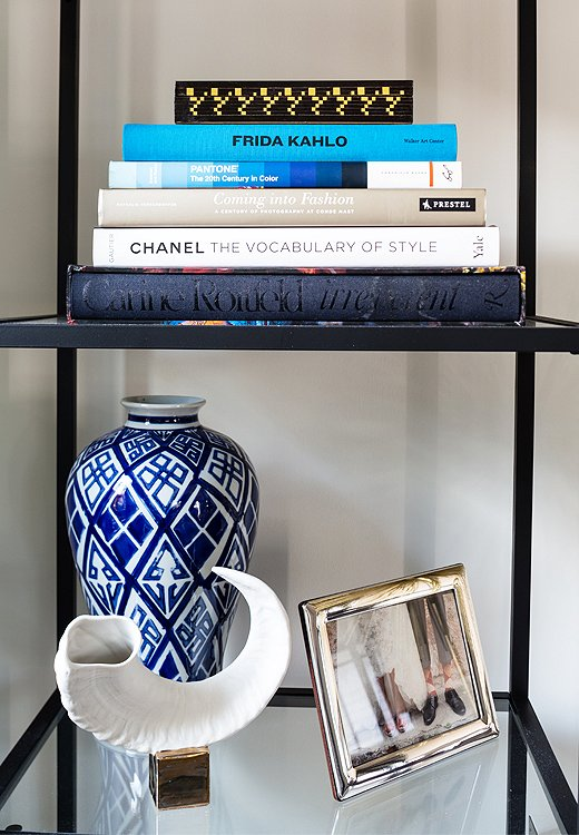 Blue-and-white ceramics are typically thought to betraditional, but mixed in with contemporary art and bone accents, they come off as fresh and edgy.