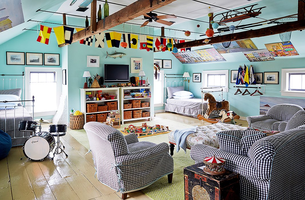 You can't go antiquing in New England without encountering a bounty of nautical ephemera. Here, nautical flags and a fishing trophy bring playful seaside flair to a kids' space. Photo by Tony Vu.