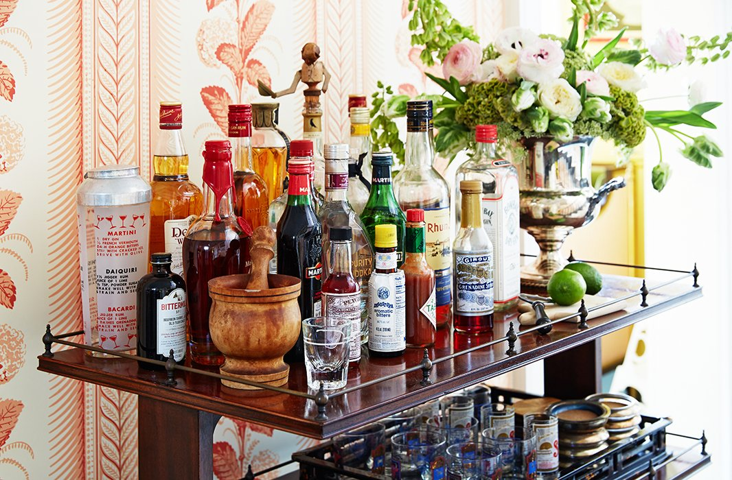 "An enviably robust bar complete with fixings, mixers, and tools is a lively addition to the entryway. ""Cocktails at six, dinner at seven, nightly without fail!"" says Jeffrey of his genteel evening agenda. His go-to tipple? ""Maker's Mark whiskey sour with lots of citrus."""