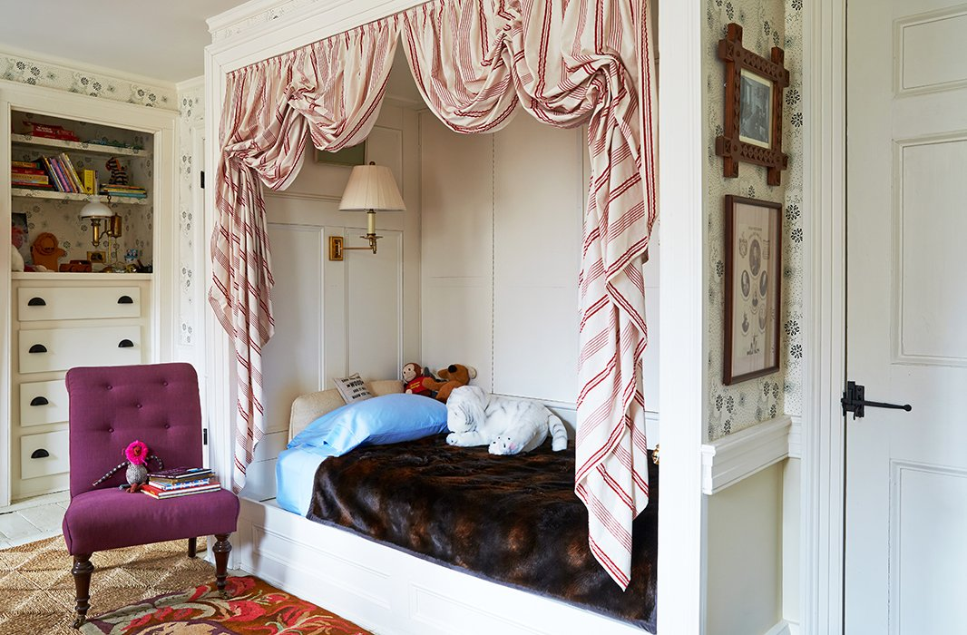 Son Christoph gets a bedroom fit for a prince, or maybe a president—the bed was modeled after one in Thomas Jefferson's Monticello bedroom. Bustled red-and-white dimity cloth gives the nook an all-American feel while creating a kid-friendly zone perfect for imaginary adventures.