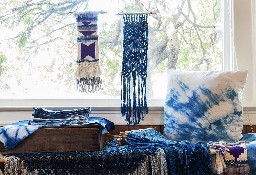 Anything-but-moody blues color all of Maya's pieces, from the soft cotton pillowcases to the intricate wall hangings to the '60s-leaning macramé.