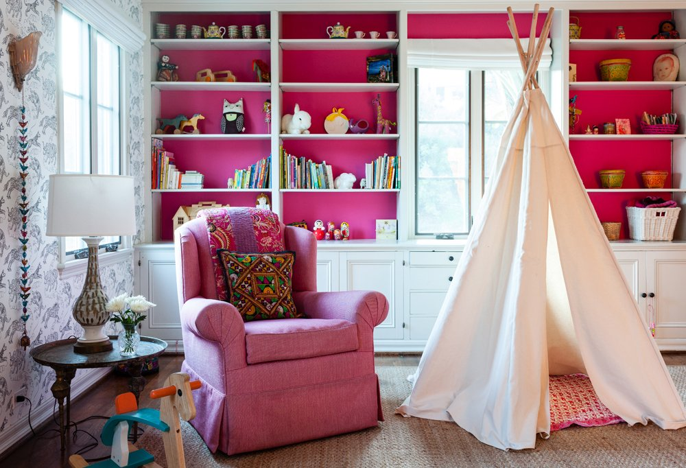 """Pink makes everything pop,"" says Tarses, who landed on Benjamin Moore's Razzle Dazzle for the back of the shelves in daughter Pippa's room. ""Now everything we put up there—whether it's one of her art projects, a doll, or a tea set—stands out so much."""