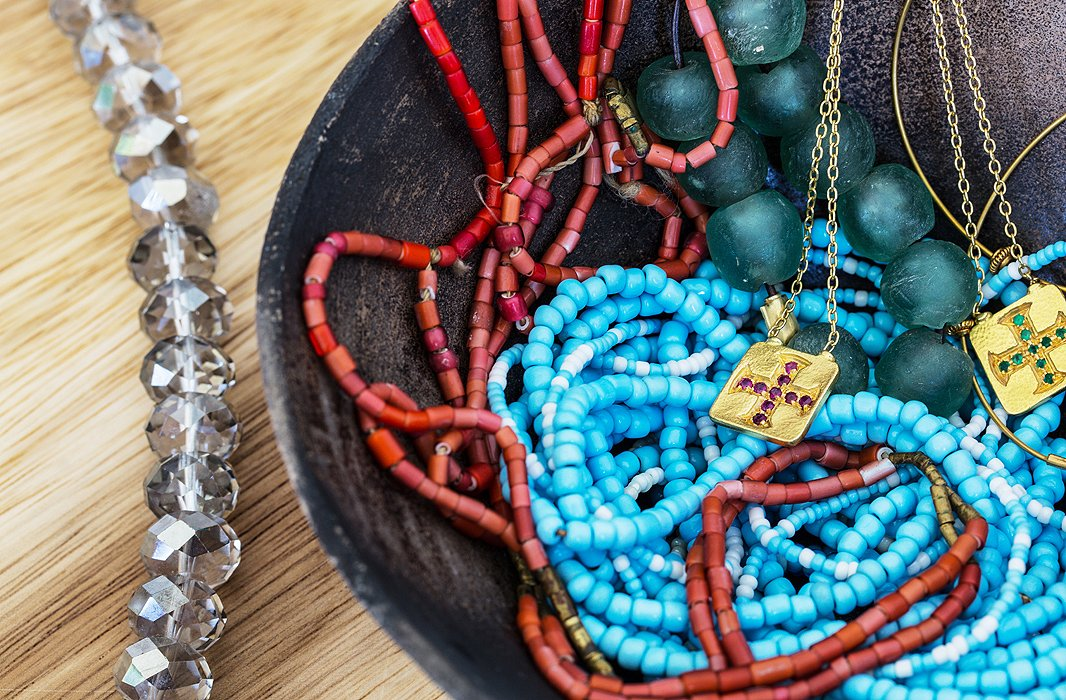 "Jewelry is casually stashed in a handcrafted Ecuadoran bowl. ""I don't wear a lot of jewelry, but I do periodically throw on some organic things like turquoise or coral beads or pearls with summer dresses."""