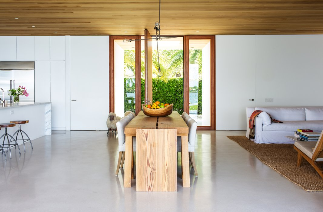 A restrained palette and unfinished woods lend a serene, casual look; the dining table was commissioned from Lars Bolander.