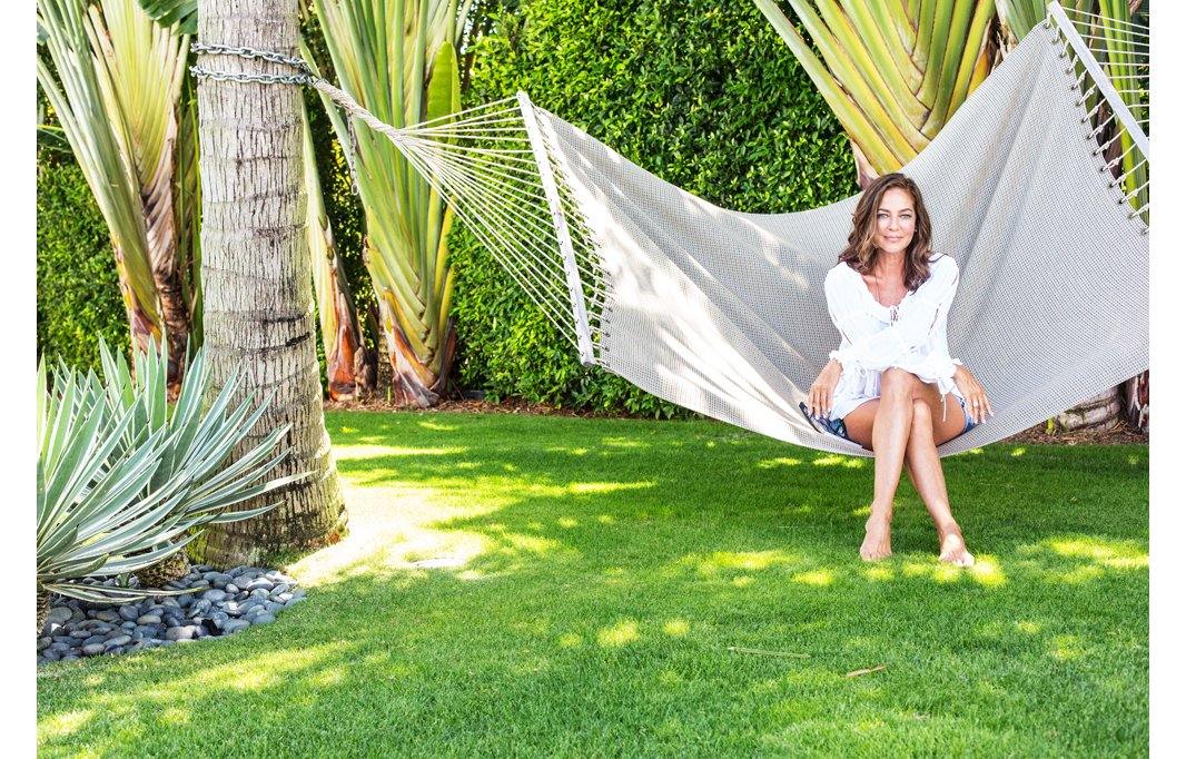 This breezy hammock is a favorite spot for Kelly to lounge and read the newspapers while she watches her son play.