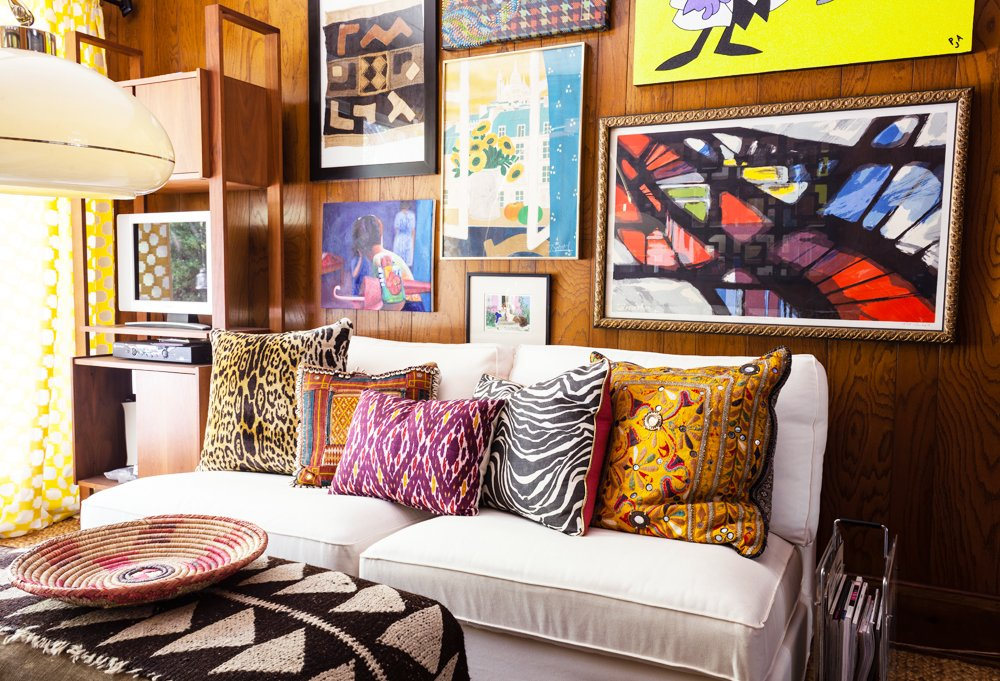 When entertaining, Kim and friends often ended up in the den, made extra cozy by vibrant art prints and patterns.