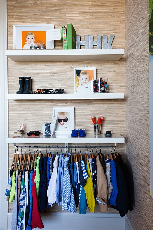 Since Holden's room doesn't have a closet, Kleinhelter had to be mindful of storage solutions, adding open shelving to the walls and stashing necessities in his credenza and under the bed.