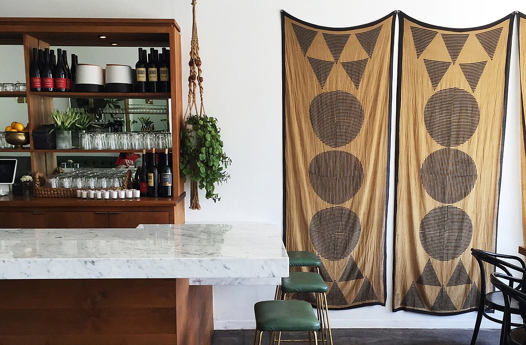 A look inside gorgeous new eatery Ostrich Farm where Indian block-printed cotton scarves from Block Shop adorn the walls.