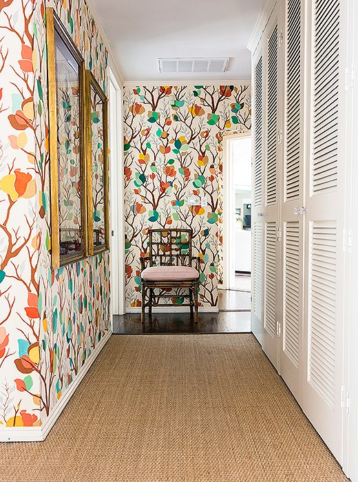 "A hallway is papered with Lulu's Bloomsbury print, while the rest of the decor stays neutral. True to her Hamptons roots, Lulu says she ""always loves a sisal. It makes a room look more earthy and rounded and good."""