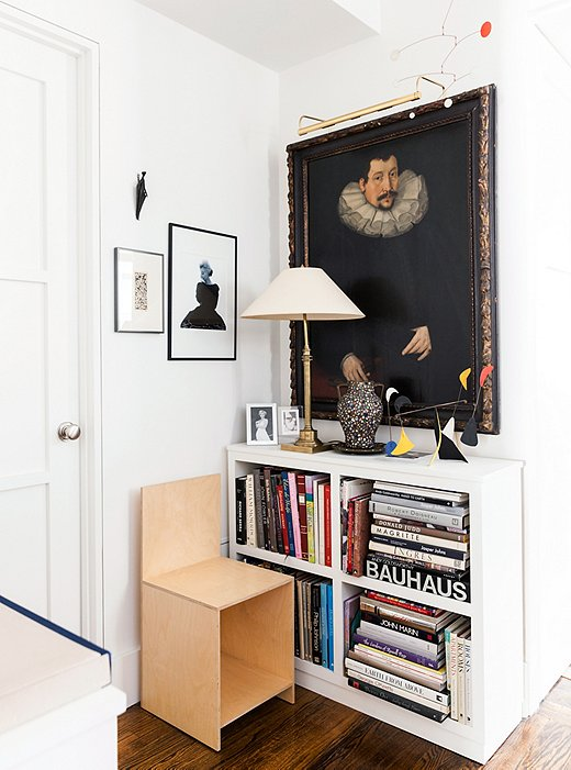 Alternating stacks of horizontal books among rows of vertical books can add visual interest—and allows you to neatly fit oversize volumes on your shelves. Photo by Lesley Unruh.