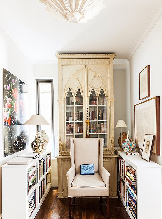 The Gothic cabinet that once occupied her London apartment now has pride of place in the library, which is also home to an invitingly comfortable armchair Mariette designed for Hickory Chair.