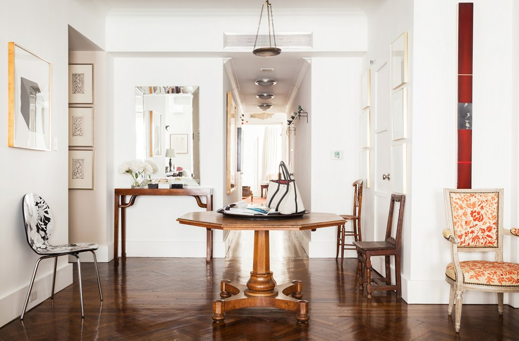 Most of the apartment's floors are bare, which highlights the shapes of Mariette's beloved chairs and helps the space feel open by allowing the eye to travel uninterrupted.
