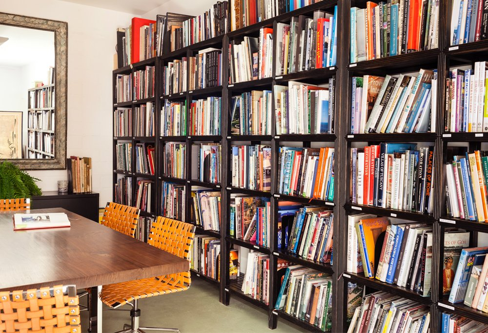The office has a dedicated design-book library, where titles are organized by designer, architect, style, or region.