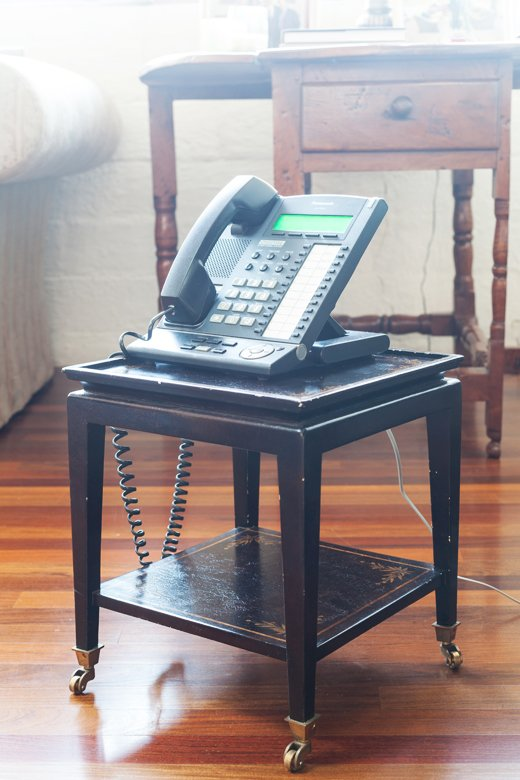 Smith's office phone sits atop an antique telephone table to ensure it can keep up with his swiveling from computer to conference table throughout the day.