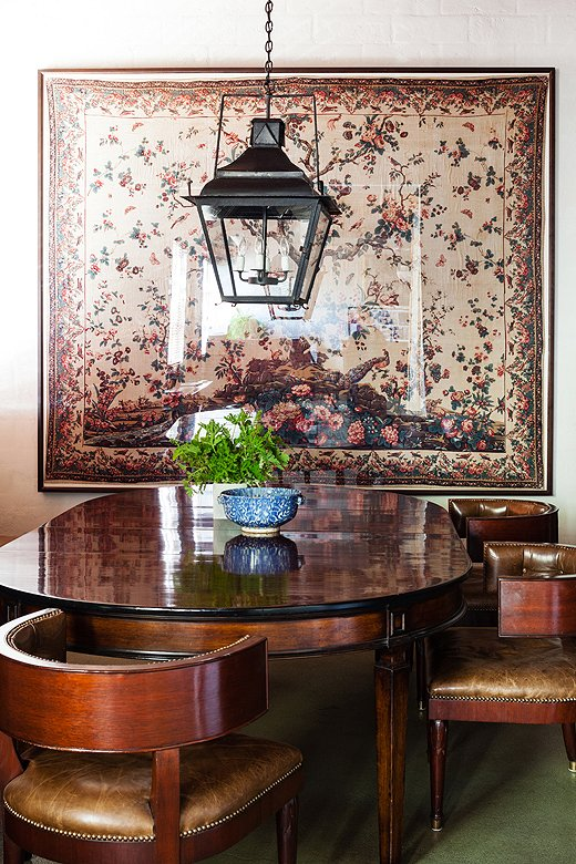 This gorgeous dining area is where Smith staffers generally gather for lunch. The framed document on the wall is part of Smith's personal collection and was the inspiration for the Tree of Life pattern in his Jasper fabric line.