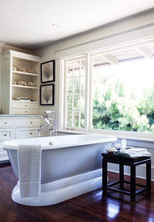 The clients' own seashore-inspired accents add a serene touch to the bathroom.