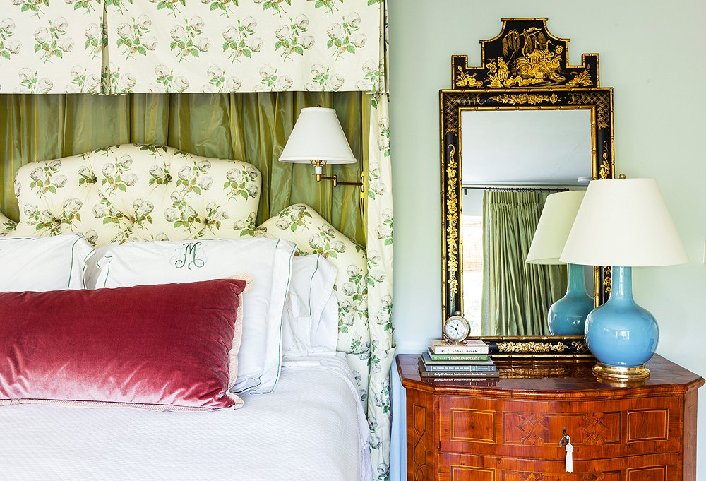 Yager designed the lovely pelmet treatment in bed drapery and headboard in Bowood by Colefax and Fowler. Another Christopher Spitzmiller lamp rests atop a vintage chinoiserie chest.