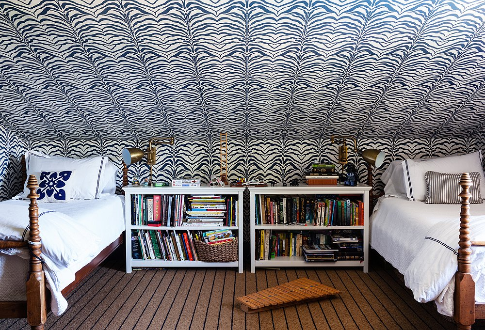 Zebrine wallpaper by Rose Cummings plays the star in this tots' room, while the dark but neutral carpettakes more of a supporting role.