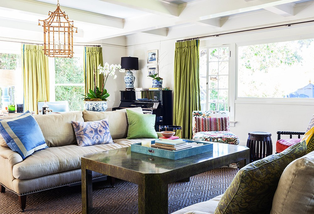 """In the living room, Yager opted for a """"chinoiserie overload""""—bamboo lanterns by John Rosselli andplenty of blue-and-white ceramics—letting the Asian influence complement the home's Craftsman bones."""