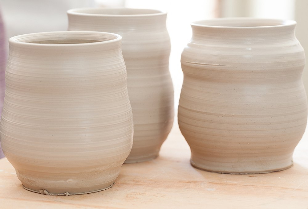 A trio of pots, ready for their first firing.