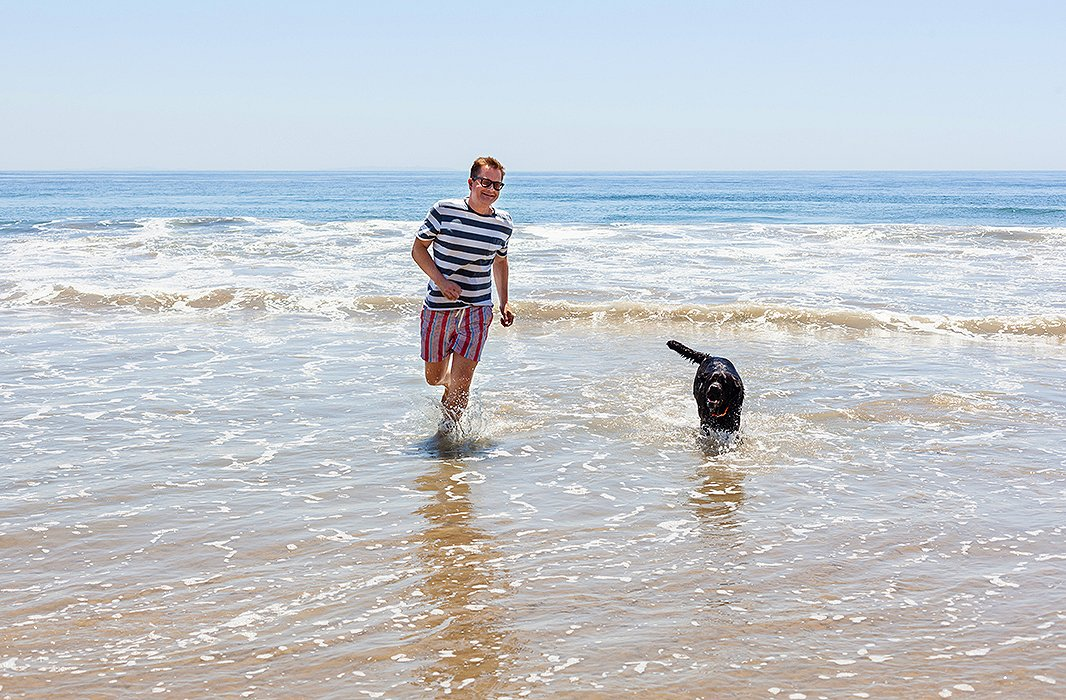 "Nathan and his dog, Nacho, who he describes as a ""beach bum,"" testing out the water after lunch."