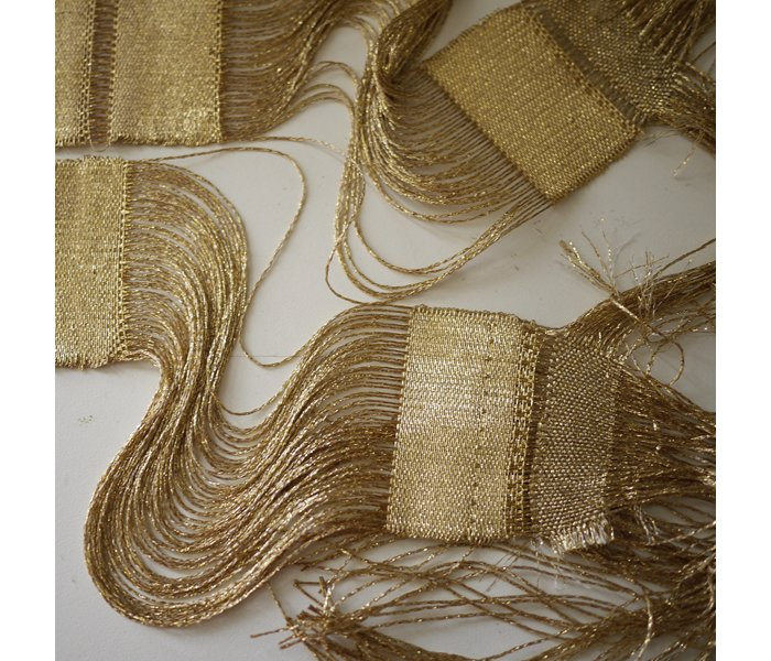 """It is believed that ancient Egyptians created gold wire by pulling soft ore into long, tiny threads, then they weaved these tiny gold threads into garments, wall ornamentations, and adornments,"" says Ashbee."