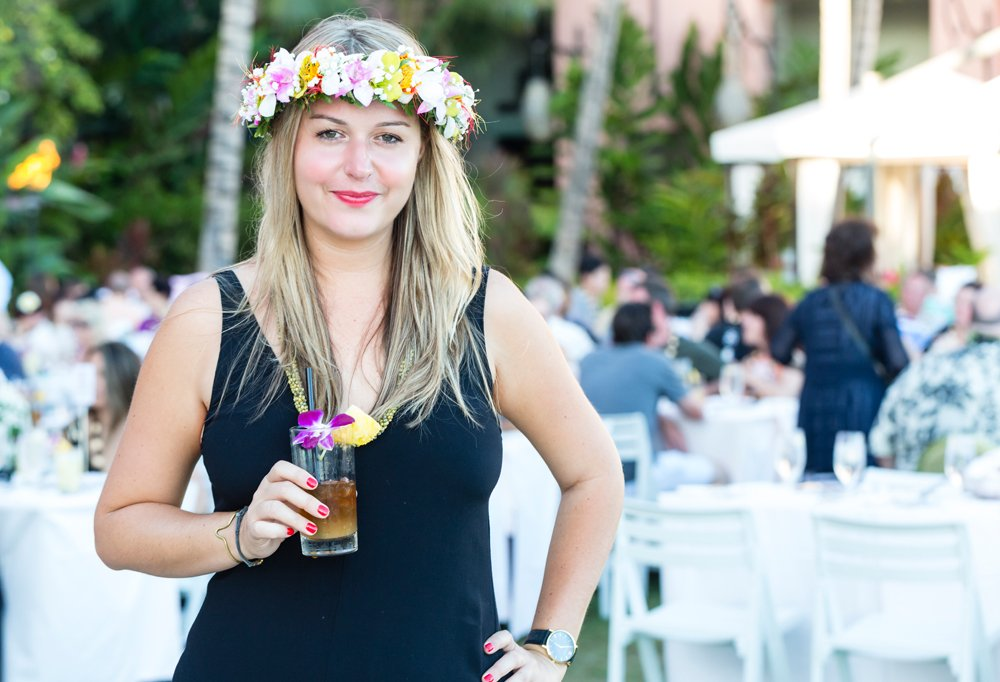 Bring on the tall drinks with tiny umbrellas! Nicole, also rocking a fresh flower crown (called a haku in Hawaiian) enjoys the festivities.