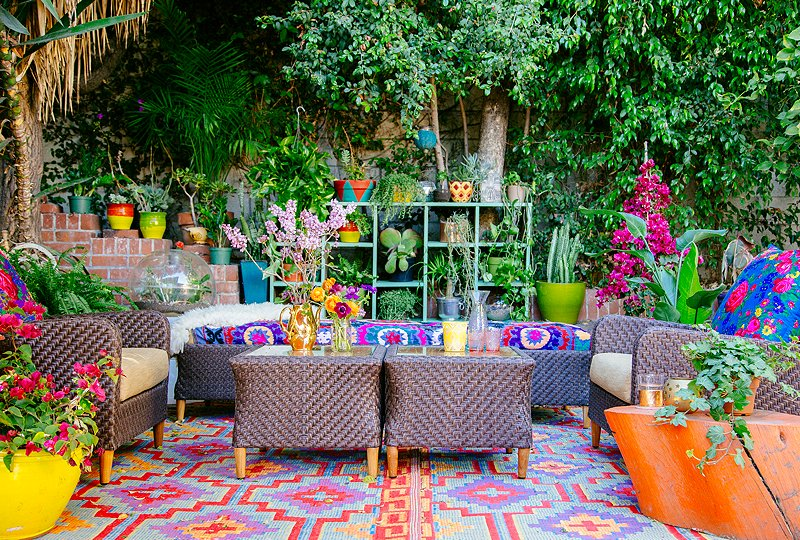 "Justina's L.A. front yard overflows with lush greenery, fanciful blooms, and kaleidoscopic colors, patterns, and textures to perfectly reflect her ""jungalow"" vibe. It's her family's outdoor living room, where they regularly hang out and entertain friends."