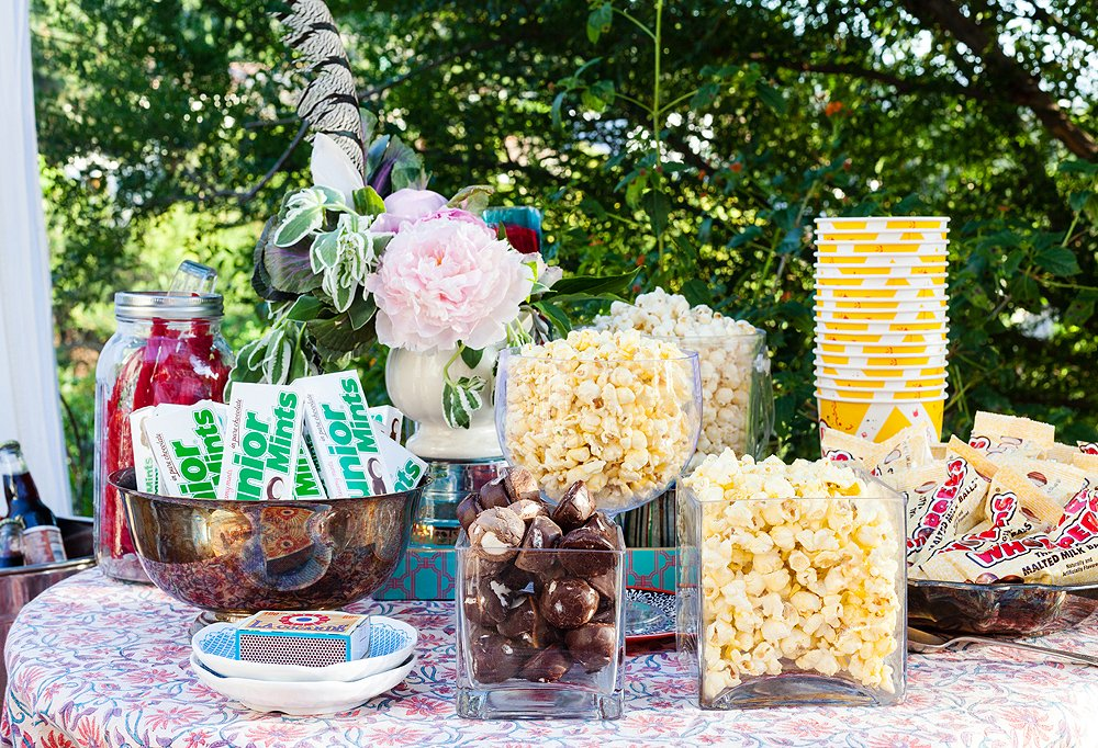 The classic candies were rounded out with gourmet chocolate-covered marshmallows, all served in vessels of different shapes, sizes, and materials to make the tablescape a bit of eye candy.