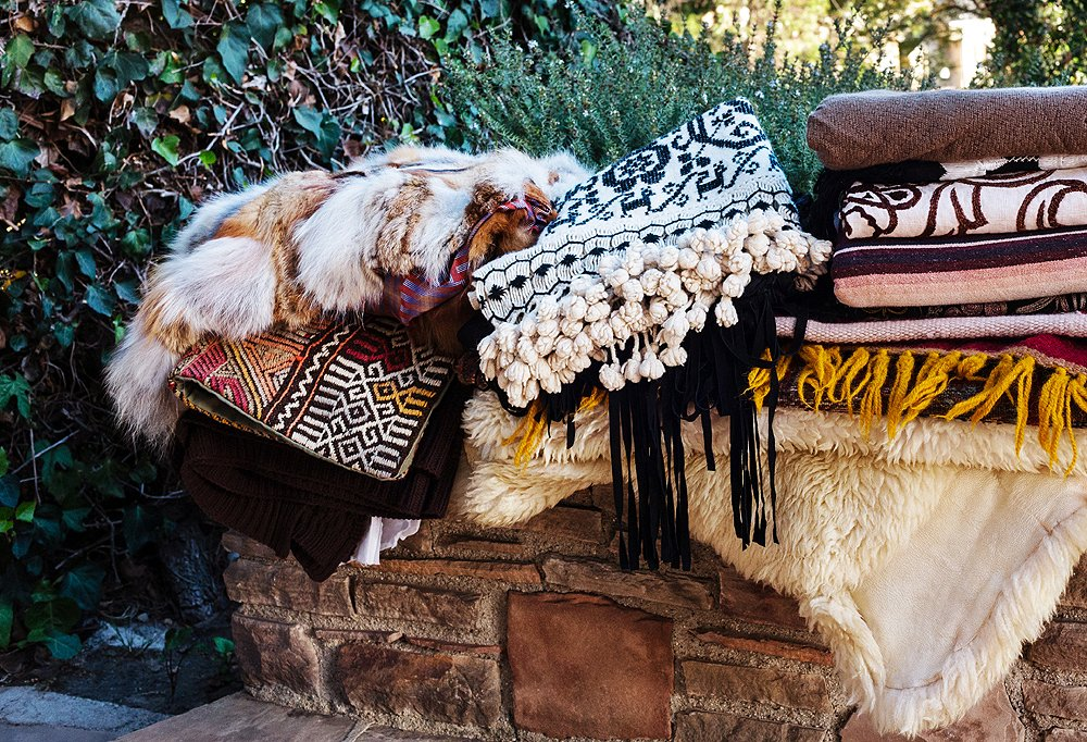 She hauled out a mix of serapes, kilims, furs, and blankets that, when layered, created a rich boho mix.